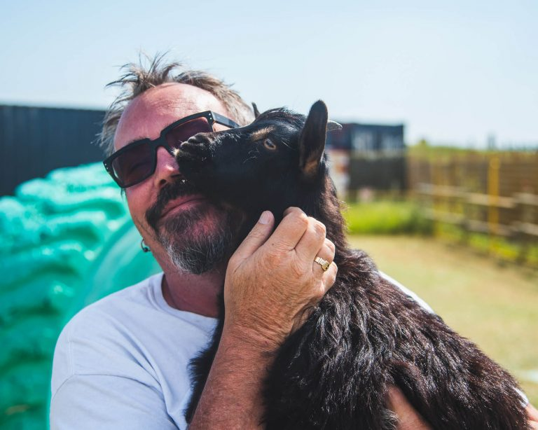 goat snuggling mike